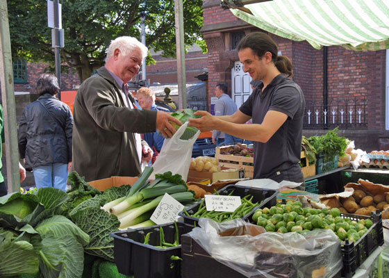 Man buying Vegetables at Ormskirk Market