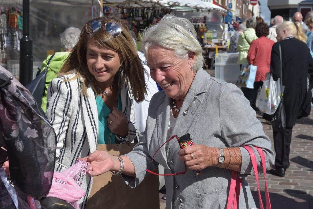 Ladies admiring clothes at Ormskirk Market