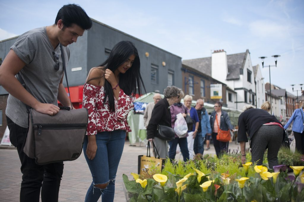 People looking at lillies at Ormskirk Market
