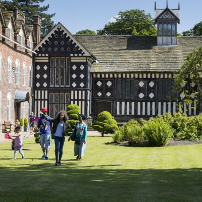 Visitors in the garden in June at Rufford Old Hall, Lancashire