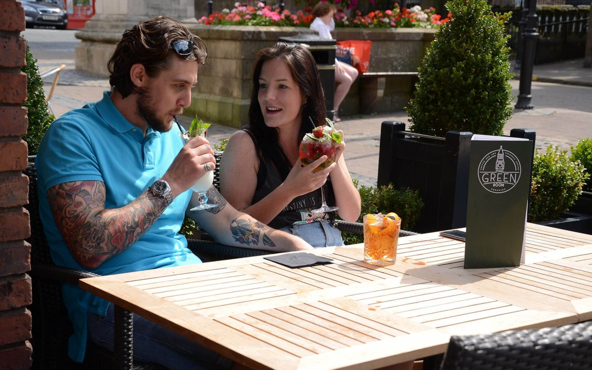 Photo of man and woman having a drink