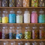 Display of filled sweet jars on shelves