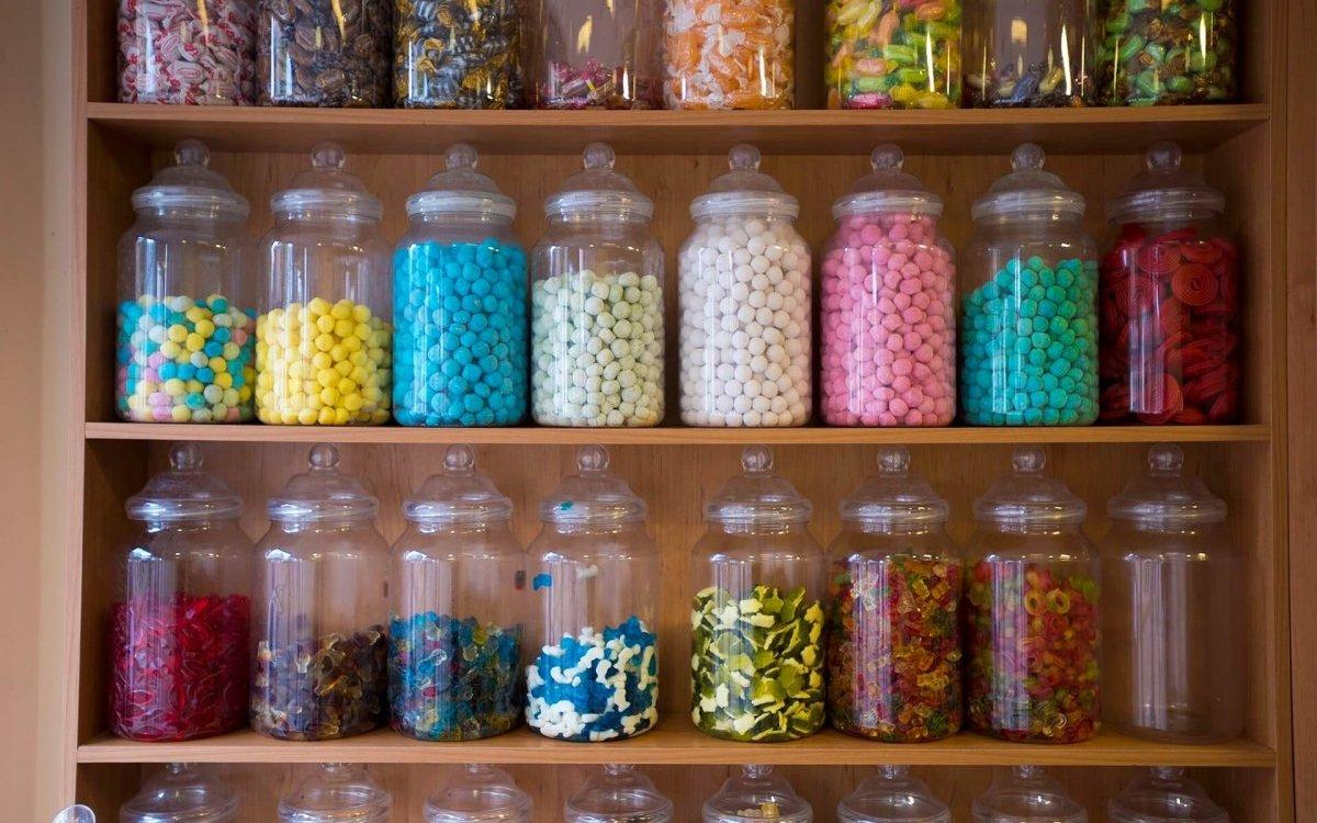 Display of filled sweet jars on shelves