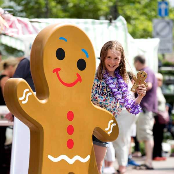 Girl posing with OCP's Gingerbread model