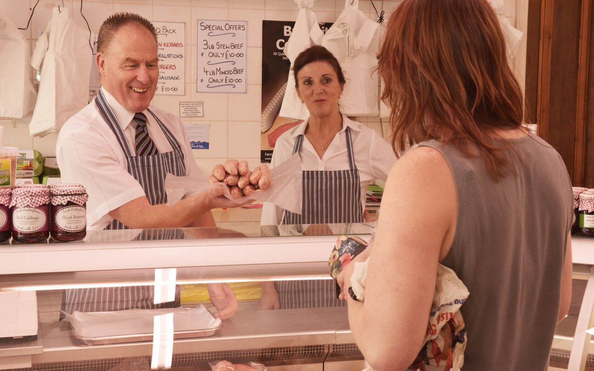 Friendly Butcher serving a customer