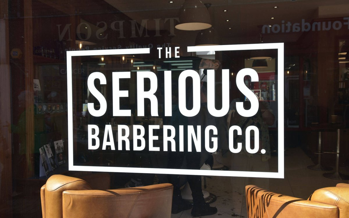 The Serious Barbering Co. vinyl on window