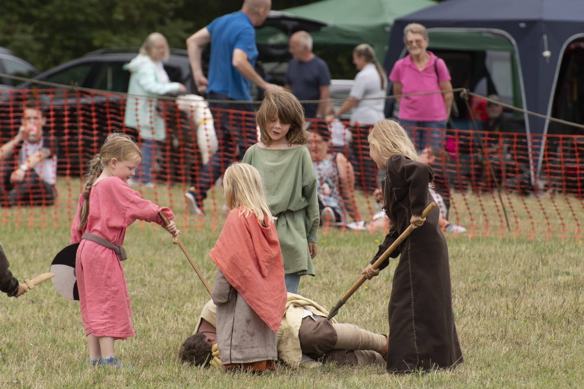 Viking children defeating their opponent in battle at Green Fayre, Beacon Country Park