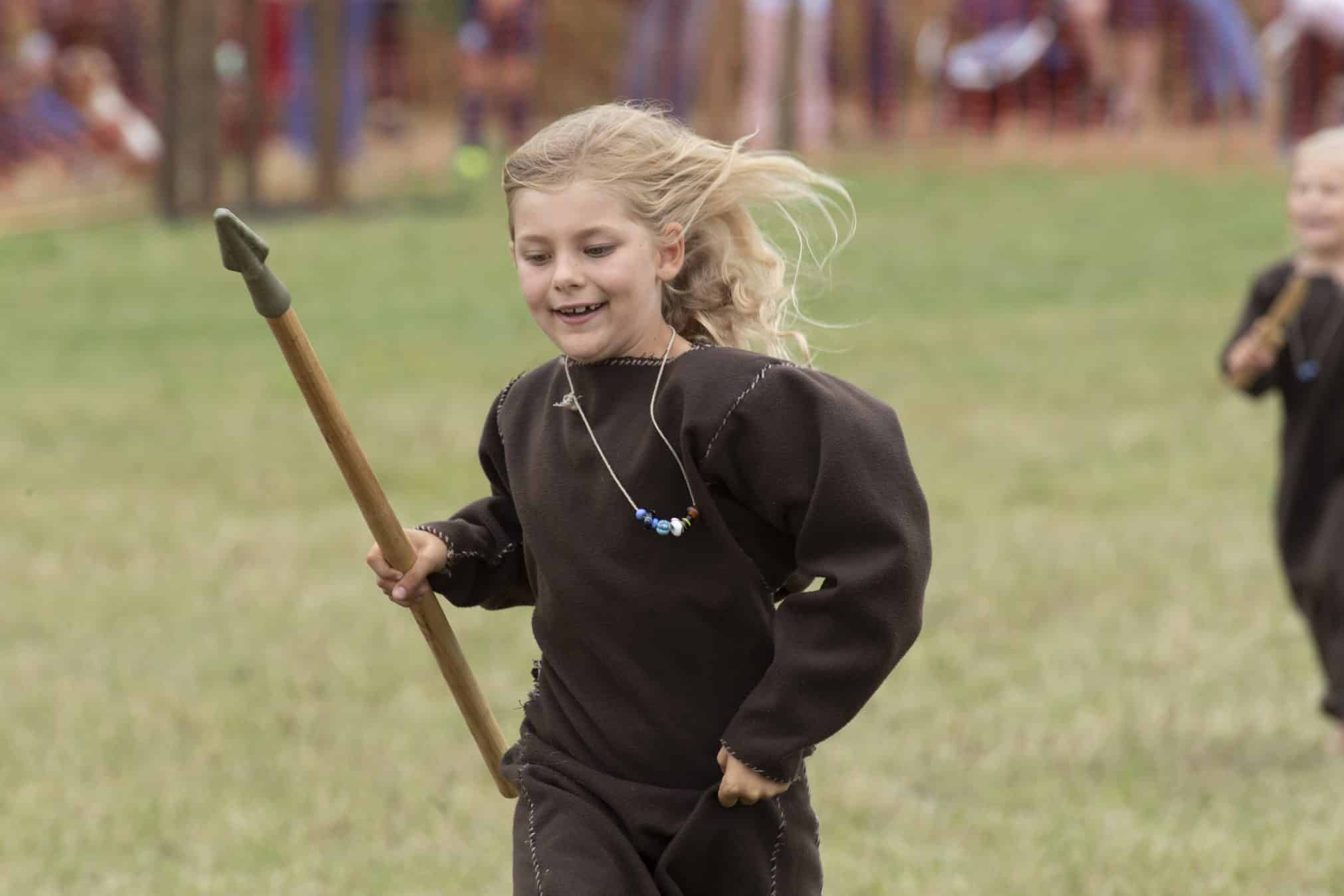 A Viking girl running with her spear at Green Fayre, Beacon Country Park