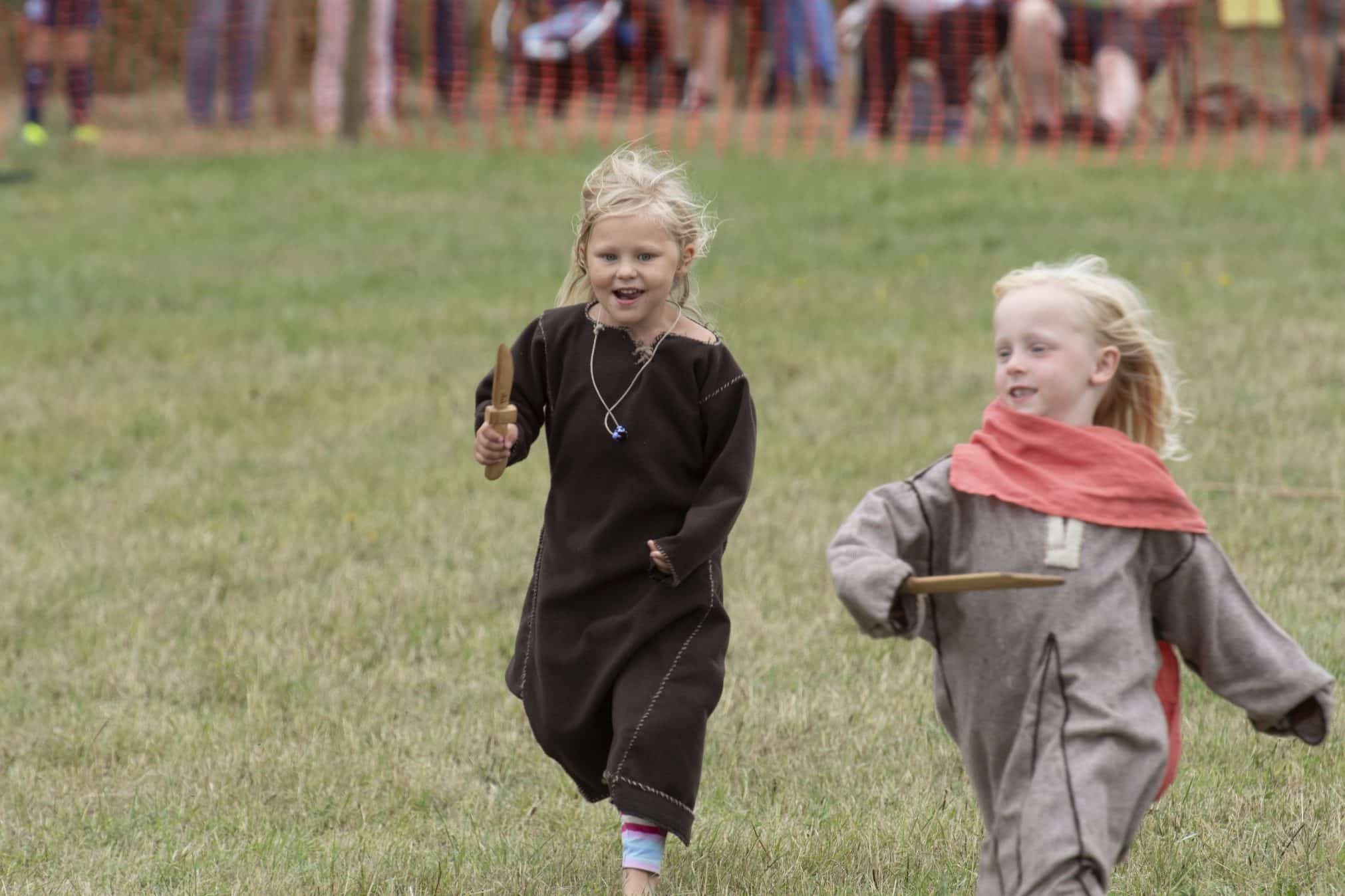 Two Viking girls running at Green Fayre, Beacon Country Park