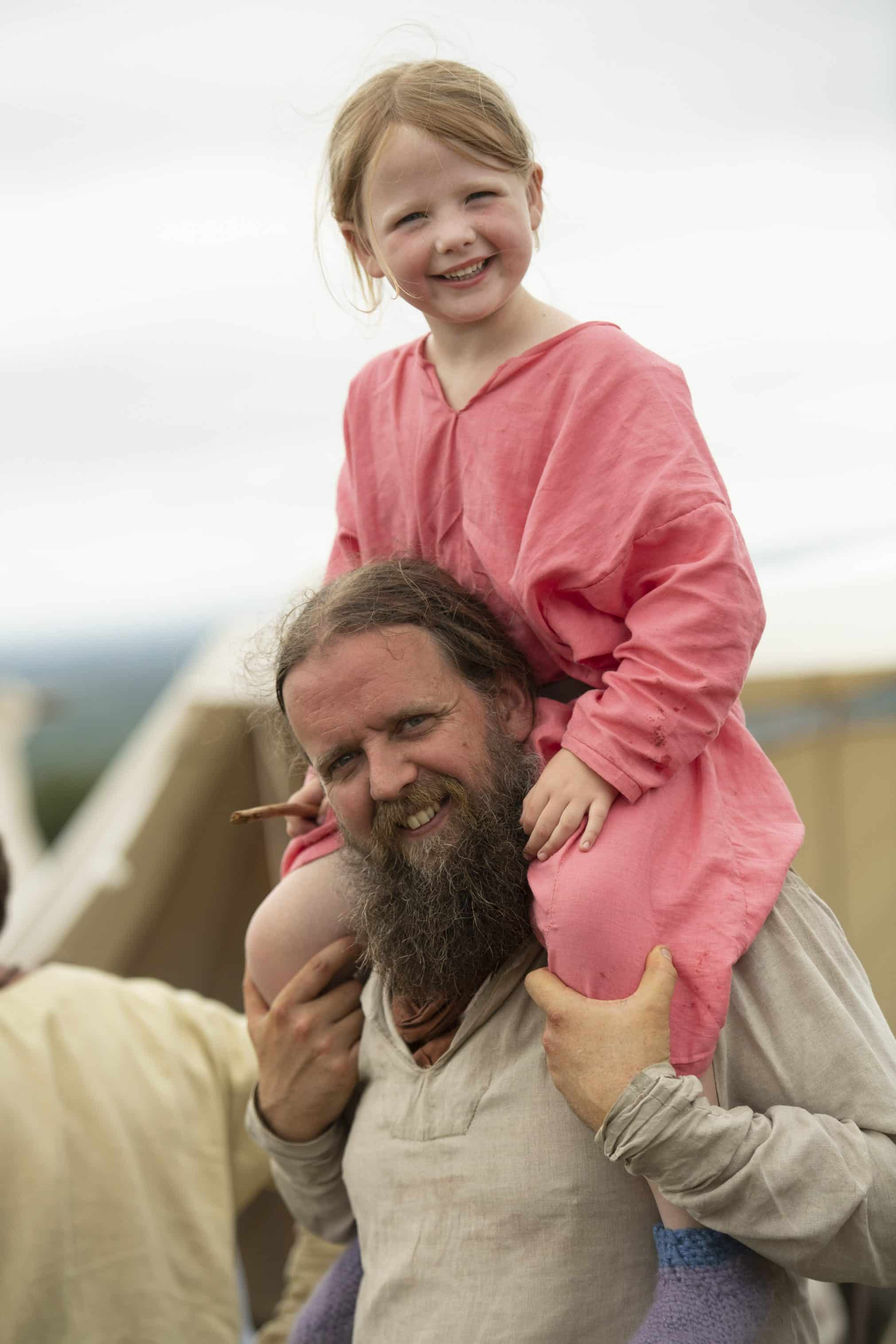 Young Viking Girl on her Dads shoulder at Green Fayre at Beacon Country Park