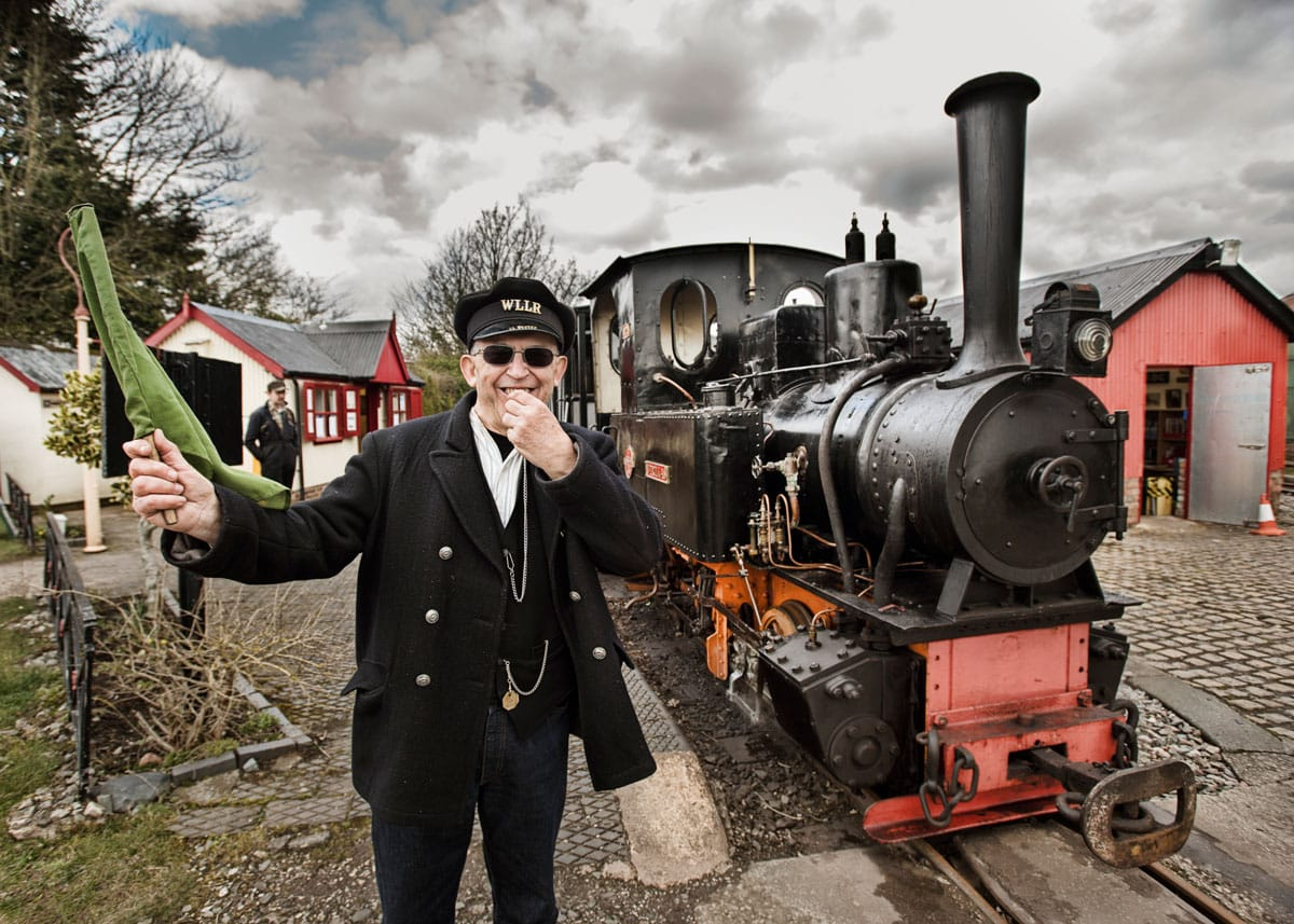 West Lancashire Light Railway, man blowing whistle next to steam engine